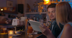 Couple with Tablet in the Bar Stock Footage