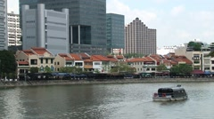 Cruise boat passes by the historical part if the city in Singapore. Stock Footage
