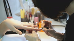 Master makes manicure girl at the beauty salon Stock Footage