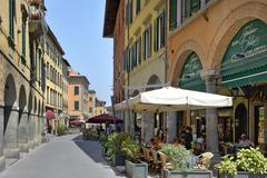 Alfresco restaurants and Porticos (covered walkways), Borgo Stretto, Pisa, - stock photo