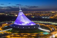 Night view over Khan Shatyr entertainment center, Astana, Kazakhstan, Central - stock photo