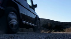 Car driving off camera. 4x4 adventure car going off road. Stock Footage