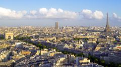 City, Arc de Triomphe and the Eiffel Tower, viewed over rooftops, Paris, France, - stock photo