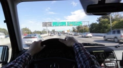 Driver POV driving on highway. Hands on steering wheel. Stock Footage