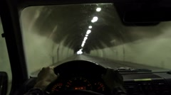 Driver POV. Person driving through a tunnel. Stock Footage