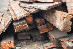 Heap of old wood planks from end view - stock photo