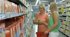 Women checking product package in the store Stock Footage