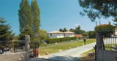View of Villa through the Open Gates Stock Footage