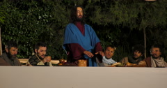 Last Supper Eucharist sharing bread - stock footage