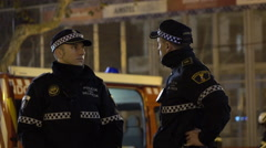 Two officers talking as they wait for Fallas fireworks 4k - stock footage