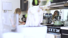 Lesbian couple checking hair in kitchen Stock Footage