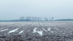 Pan shot across barren icy field with a frosty haze in the background - stock footage