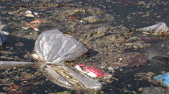 Water littered with trash and other pollutants 4k Stock Footage