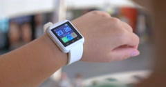 Woman changing settings on smart watch - stock footage