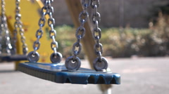 Swing swaying in wind of empty playground 4k Stock Footage