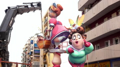 Fallas sculpture being assembled in downtown Valencia Spain Stock Footage