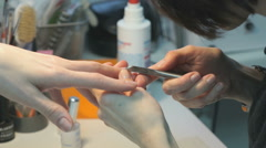 Master making the manicure girl at a beauty salon Stock Footage