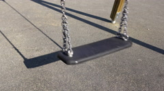 Playground swing on sunny day empty 4k Stock Footage