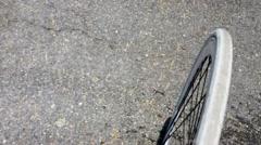 Bike wheel riding in asphalt. Stock Footage
