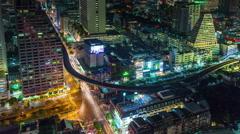 Night illumination bangkok silom traffic crossroad 4k time lapse thailand Stock Footage
