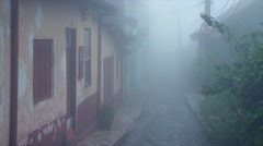 Small town mist : Rainy day in village Stock Footage