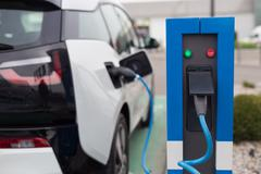 Electric Car in Charging Station. Stock Photos