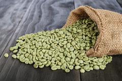 Green coffee beans Stock Photos