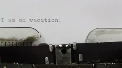 Typing Note - I am on Vacation on Typewriter  - stock footage