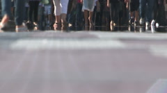 Crowds of people walking and commuting to work. Low angle shot of feet Stock Footage