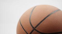 Macro Shot of Basketball on white background Stock Footage