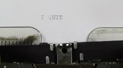 Typing I QUIT on typewriter Stock Footage