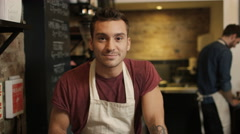 4K Cafe worker serving customer & taking payment, seen from customer's pov - stock footage