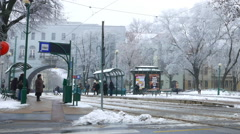 Horizontal panning view of a tram stop in the centre of Szeged in winter Stock Footage