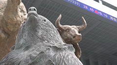 Shenzhen stock exchange, bear and bull statue, ticker board, China economy Stock Footage