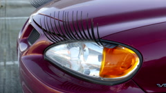 Close up headlights of car with eyelash with 4k resolution Stock Footage