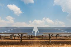 The solar farm for green energy in the field - stock photo