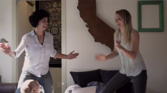 Lesbian mothers and son dancing in living room Stock Footage