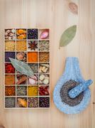 Assortment of spices food cooking ingredients in wooden box and mortar  set u Stock Photos