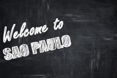 Chalkboard background with chalk letters: Welcome to sao paulo - stock illustration