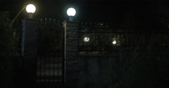 View on illuminated gates made of stone and metal Stock Footage