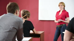 Female teacher giving a lecture at the University Arkistovideo