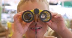 Child looking through the binoculars Stock Footage