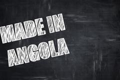Chalkboard background with chalk letters: Made in angola - stock illustration
