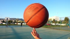 Basketball Spinning on Finger in Open Area Stock Footage