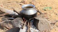 Metal pot with food on fire, Pushkar, India . Close up - stock footage