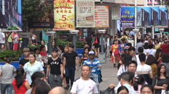 Pedestrians visit a busy popular shopping street in Shenzhen, China Stock Footage