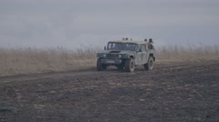 RUSSIA ST.PETERBURG- : terrorists riding in a jeep through the - stock footage