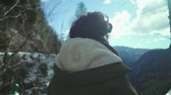 Free serious woman thinking,  looking at the valley - stock footage