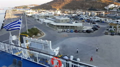 Mykonos, Greece - New port. Greek flag on a ship. Stock Footage