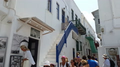 Mykonos, Greece. Tourists walking in the narrow paths of Chora. Stock Footage